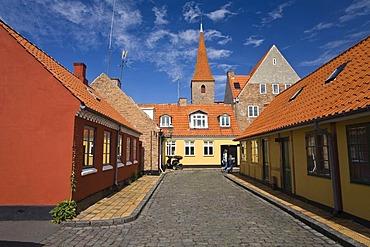 Street, houses and church in Ronne, Bornholm, Denmark, Europe