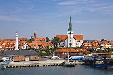 Timber-frame houses, lighthouse and church Skt. Nicolaj Kirke in Ronne, Bornholm, Denmark, Europe