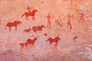 Painted rider and goats, neolithic rockart of the Acacus Mountains or Tadrart Acacus range, Tassili n'Ajjer National Park, Unesco World Heritage Site, Algeria, Sahara, North Africa