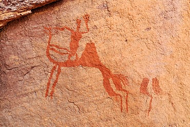 Camel rider, neolithic rockart of the Acacus Mountains or Tadrart Acacus range, Tassili n'Ajjer National Park, Unesco World Heritage Site, Algeria, Sahara, North Africa