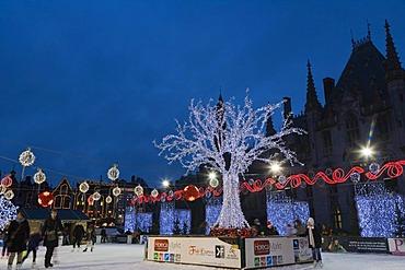 The ice rink on the Grote Markt market square in winter, Bruges, Brugge, West Flanders, Flemish Region, Belgium, Europe