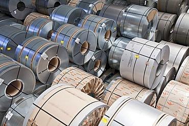 Finished flat steel rolls waiting for shipment, steelworks of ArcelorMittal, Eisenhuettenstadt, Brandenburg, Germany, Europe