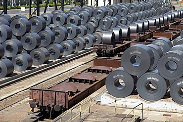 Finished flat steel rolls waiting for shipment by freight train, steelworks of ArcelorMittal, Eisenhuettenstadt, Brandenburg, Germany, Europe
