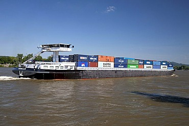 Cargo boat, container ship travelling on the Rhine River, Bonn, Rhineland region, North Rhine-Westphalia, Germany, Europe