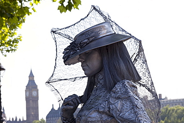 Human statue street performer, Southbank, London, England, United Kingdom, Europe