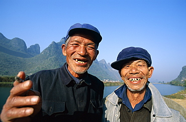 Two local men dressed in Mao suits, Guilin, Yangshou, Guangxi Province, China, Asia