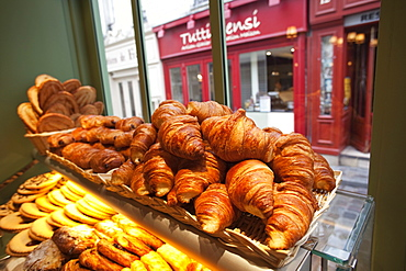 Croissants and pastries on display in patisserie shop, Paris, France, Europe