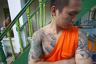 Monk with tiger tatoo on upper arm, Bangkok, Thailand, Southeast Asia, Asia