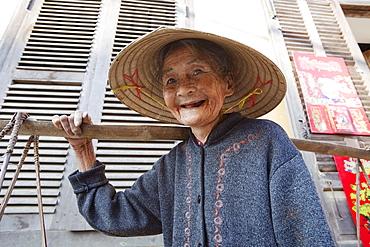 Portrait of elderly woman, Hoi An, Vietnam, Indochina, Southeast Asia, Asia