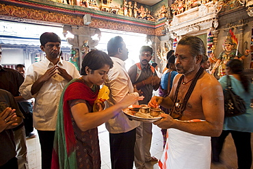 Hindu devotees in the Sri Veerama-kaliamman Temple, Little India, Singapore, Southeast Asia, Asia