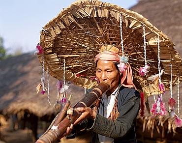 Meo hill tribe man smoking pipe, Chiang Rai, Golden Triangle, Thailand, Southeast Asia, Asia