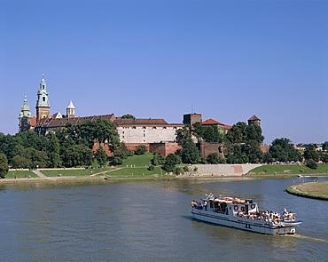 Wawel Castle, Vistula River and tour boat, Cracow (Krakow), Poland, Europe