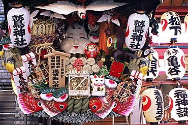 Decorative good luck rakes for sale at the Tori-no-Ichi Festival held annually in November at Otori Shrine, Tokyo, Honshu, Japan, Asia