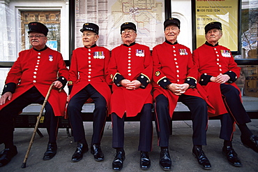 Chelsea Pensioners sitting at bus stop, London, England, United Kingdom, Europe