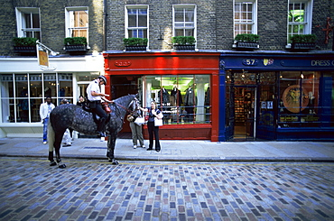 Mounted policeman in Monmouth Street, Soho, London, England, United Kingdom, Europe