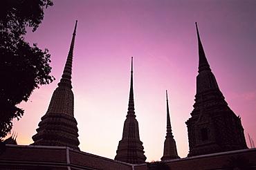 Silhouette of stupas at dawn, Wat Pho, Bangkok, Thailand, Southeast Asia, Asia