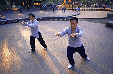 People doing Tai-chi in Lumphini Park, Bangkok, Thailand, Southeast Asia, Asia
