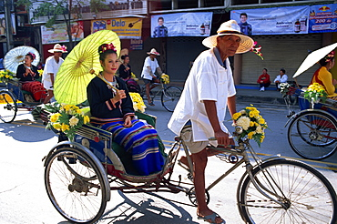 Girl sitting in trishaw at the Chiang Mai Flower Festival Parade, Chiang Mai, Thailand, Southeast Asia, Asia