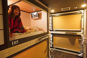 Girl in room, Capsule Ryokan Kyoto Hotel, Kyoto, Japan, Asia