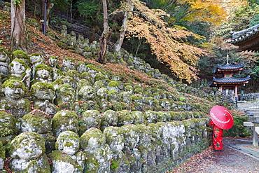Carved stone figures of Rakan, disciples of Shaka the founder of Buddhism, Otagi Nembutsu-ji Temple, Arashiyama, Kyoto, Japan, Asia