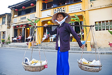 Woman wearing conical hat, Old Town, Hoi An, Vietnam, Indochina, Southeast Asia, Asia