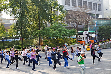 People doing Tai Chi exercise, Central, Hong Kong, China, Asia
