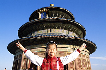 Girl posing outside the Temple of Heaven, Beijing, China, Asia