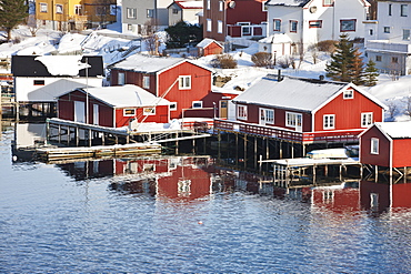 Wooden cabins at the waters edge in the town of Raine in the Lofoten Islands, Arctic, Norway, Scandinavia, Europe