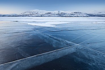A frozen lake, so clear its possible to see through the ice, near Absiko, Sweden, Scandinavia, Europe