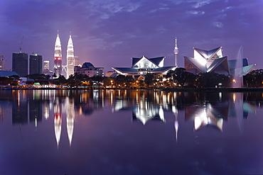 The remarkable Kuala Lumpur skyline, reflected in a lake at Titiwangsa in Kuala Lumpur, Malaysia, Southeast Asia, Asia