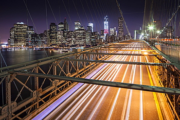 Traffic leaves colourful trails along the Brooklyn Bridge in New York, New York State, United States of America, North  America