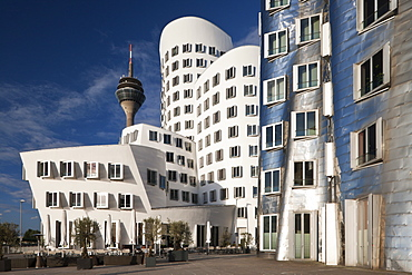 Neuer Zollhof office buildings with Rheinturm in background, Medienhafen, Dusseldorf, Germany, Europe