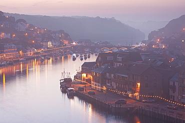 Sea fog builds over the town of Looe, Cornwall, England, United Kingdom, Europe