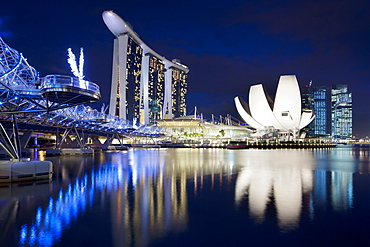 Marina Bay Sands Hotel, Lotus Flower and the Helix bridge at dusk in Singapore, Southeast Asia, Asia
