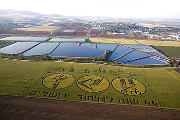 Aerial photograph of an inscription in a green field celebrating the 40th anniversary of the unification of the city of Jerusalm in 1967, Israel