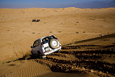 Photograph of SUV's in the Jordanian desrt