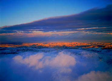 Aerial view of the Judea desert over clouds after a storm, Israel
