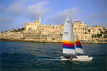Aerial photograph of a catamaran and the old city of Jaffa, Israel