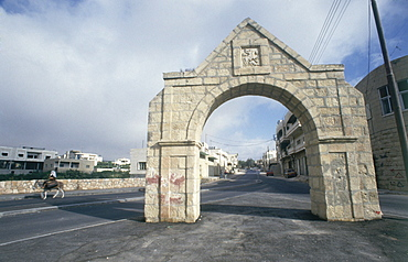 Photograph of an ancient gate in the modern town of El Hader in Judea, Israel