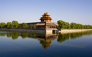 The northwest corner tower and water filled moat surrounding The Forbidden City, Beijing, China, Asia