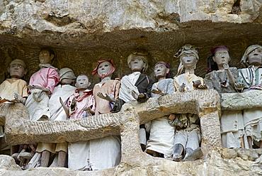 Effigies of the dead in cliffs, Toraja cemetery, Lemo, Tana Toraja, Toraja, Sulawesi, Celebes, Indonesia, Southeast Asia, Asia
