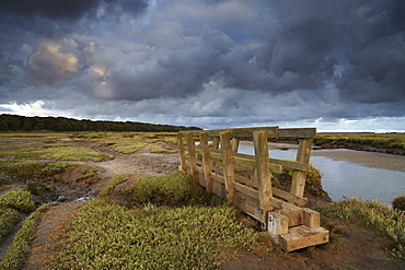 Stromy clouds over the saltmarshes at Stiffkey, Norfolk, England, United Kingdom, Europe