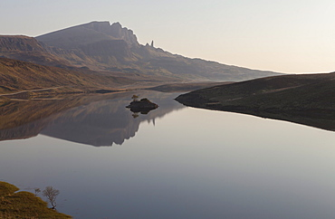 The Storr reflected in the calm waters of Loch Fada, Trotternish, Isle of Skye, Scotland, United Kingdom, Europe