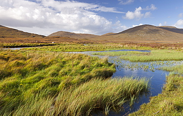 A view of the Hills of South Harris and Loch Steisebhat near Leverburgh, Isle of Harris, Outer Hebrides, Scotland, United Kingdom, Europe