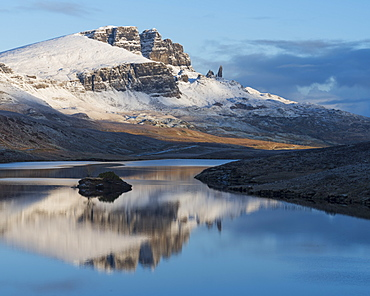 The Storr reflected in the calm waters of Loch Fada on a winter morning, Isle of Skye, Inner Hebrides, Scotland, United Kingdom, Europe