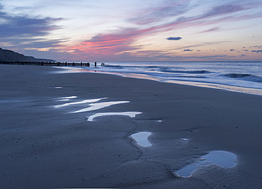 Beautiful sunset colours over the beach at low tide at Mundesley, Norfolk, England, United Kingdom, Europe