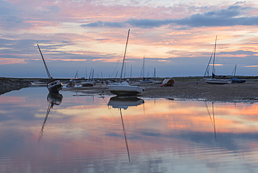 Sunset over the tidal channel at Brancaster Staithe, Norfolk, England, United Kingdom, Europe