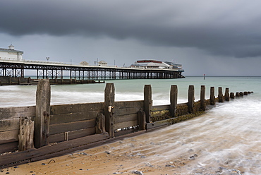 A stormy sky over the beach and pier at Cromer, Norfolk, England, United Kingdom, Europe