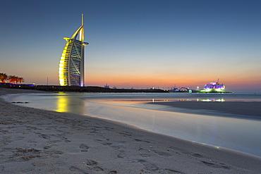 Burj Al Arab Hotel after sunset on Jumeirah Beach, Dubai, United Arab Emirates, Middle East