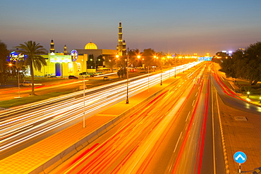 Sultan Qaboos Grand Mosque and traffic on Sultan Qaboos Street at sunset, Muscat, Oman, Middle East